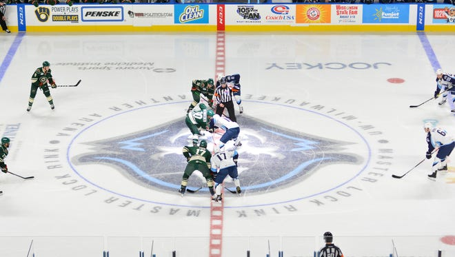 Jordan Schroeder of the Iowa Wild and Felix Girard of the Milwaukee Admirals take the opening faceoff for the Admirals' return to the UWM Panther Arena in 2016.