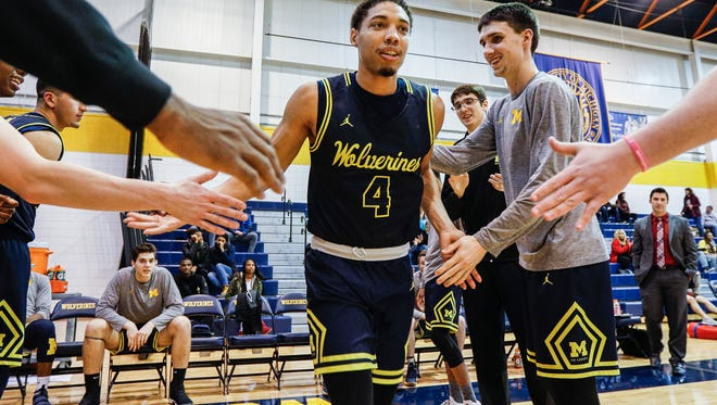 U-M Dearborn guard Mafiaion Joyner (4) is being introduced before an NAIA men's basketball game against Aquinas College at U-M Dearborn fieldhouse in Dearborn, Thursday, Jan. 11, 2018.