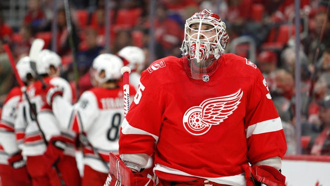 Red Wings goaltender Jimmy Howard (35) reacts after getting scored on by Hurricanes center Elias Lindholm (behind) during the first period on Saturday, Jan. 20, 2018, at Little Caesars Arena.