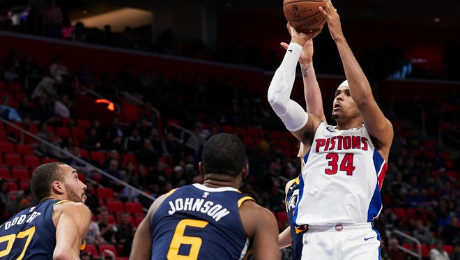 Pistons forward Tobias Harris (34) shoots over Jazz center Rudy Gobert (27) and guard Joe Johnson (6) in the first half  on Wednesday, Jan. 24, 2018, at Little Caesars Arena.