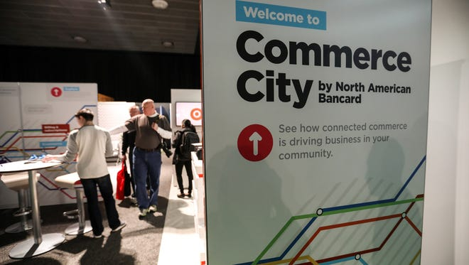 The North American Bancard Commerce City booth seen during the first public day of the North American International Auto Show in downtown Detroit on Saturday, Jan. 20, 2018.