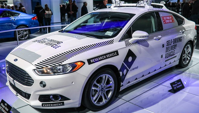 The Driverless Ford Fusion Hybrid, which was used as a pizza delivery vehicle, on display at the Ford exhibit at the North American International Auto Show in Detroit on Thursday, Jan. 25, 2018.