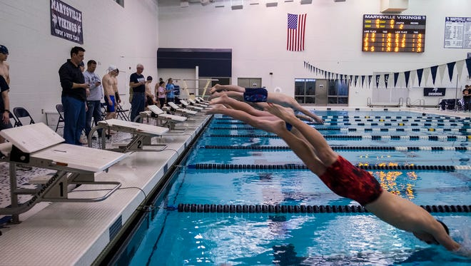 Swimmers from area high schools dive into the pool at the start of one of the heats of the Boys 50 yard Freestyle race at the St. Clair County swim meet at Marysville High School Jan. 25.