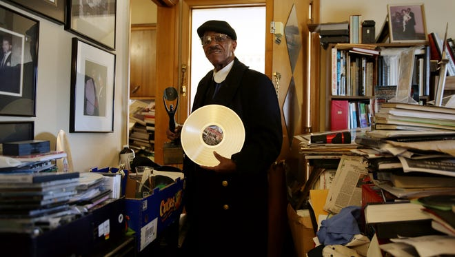 Artist Norman Thrasher, 84 holds a trophy from his induction into the Rock and Roll Hall of Fame and the Rhythm and Blues Hall of Fame at his home in Detroit on Friday, January 26, 2018. Trasher is being evicted from his home because his landlord believes that he has created an unsafe living environment by storing large number of what he says is his memorabilia accumulated through the years.