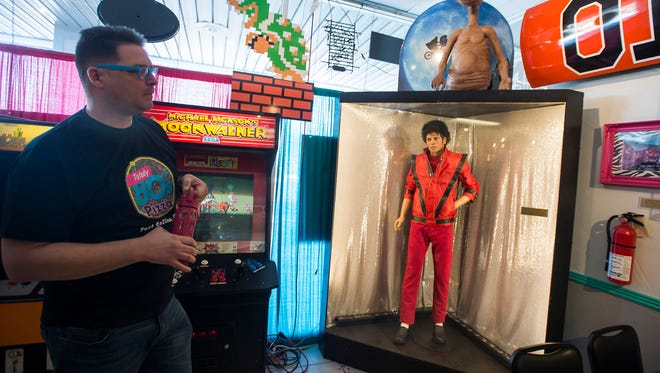 Owner Alex Morgan shows a life-size replica of Michael Jackson on display on Tuesday, Jan. 23, 2018, at Totally 80's Pizza & Museum in Fort Collins, Colo.