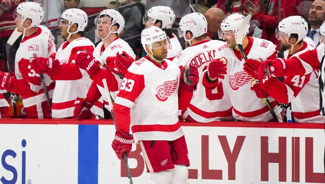 Detroit Red Wings defenseman Trevor Daley (83) celebrates his second period goal against the Carolina Hurricanes at PNC Arena on Friday, Feb. 2, 2018.