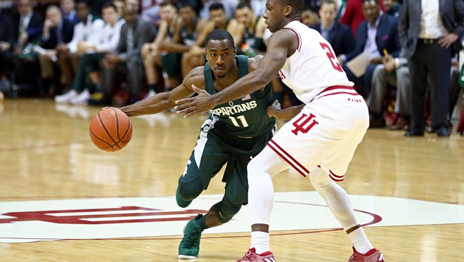 Michigan State Spartans guard Lourawls Nairn Jr. (11) controls the ball against Indiana Hoosiers guard Josh Newkirk (2) in the first half at Assembly Hall, Saturday, Feb. 3, 2018.