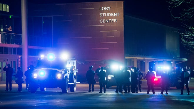 Police begin slowing clearing out the plaza in from t of the Lory Student Center after a protest of Charlie Kirk, a speaker for national conservative group Turning Point USA, on Friday, Feb 2, 2018, at the Lory Student Center on campus at Colorado State University in Fort Collins, Colo.