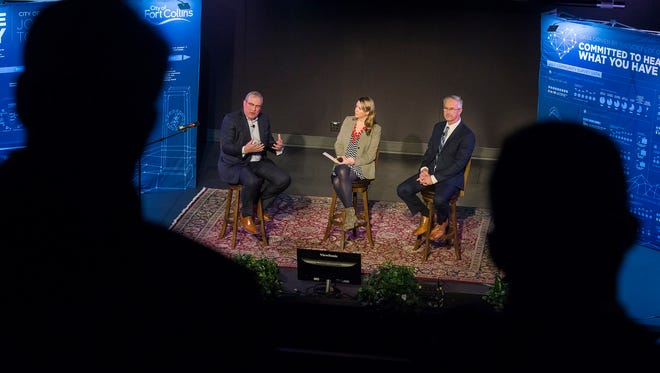 Fort Collins mayor Wade Troxell, Communications and Public Involvement Director Amanda King and City Manager Darin Atteberry speak to a crowd during the annual State of the City Address on Monday, Feb. 5, 2018, at Washington's in Fort Collins, Colo.