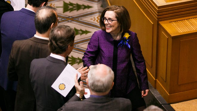 Gov. Kate Brown greets members of the Oregon Senate as she arrives for the State of the State address on Monday, Feb. 5, 2018, at the Oregon State Capitol in Salem.
