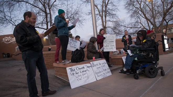 Protestors gather outside City Hall to support the building of 20 lockers for use at the Fort Collins Mennonite Fellowship before a City Council meeting on Tuesday, Feb. 6, 2018, at City Hall in Fort Collins, Colo.