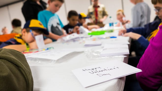 Members of Cub Scout Pack 154 and their families signed Valentine's Day cards at Colonial Woods Missionary Church on Feb. 5, 2018. The cards will be given to Meals on Wheels and distributed on Valentine's Day.
