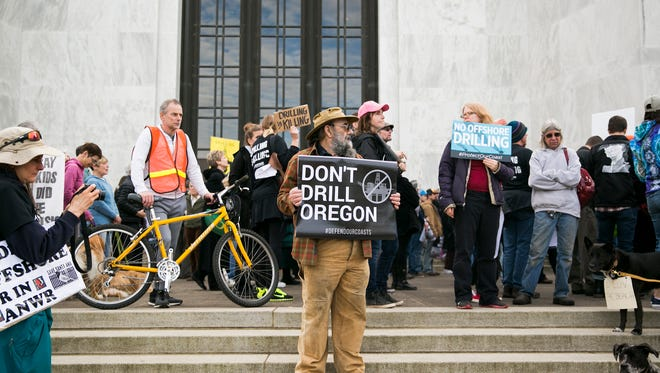 Mike Forster of Albany holds a sign at a rally protesting offshore drilling on Tuesday, Feb. 6, 2018, at the Oregon State Capitol.