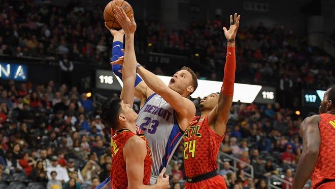 Pistons forward Blake Griffin (23) shoots over Hawks forward Ersan Ilyasova (7) during the first half on Sunday, Feb. 11, 2018, in Atlanta.