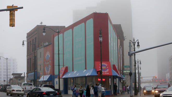 Fog engulfs downtown Detroit causing low visibility.