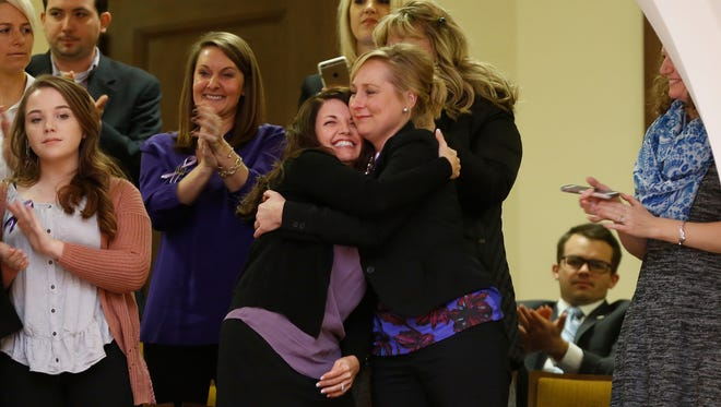 """Ashlea Christiansen, state director of Marsy?s Law for Kentucky, gets a hug after the passage of Senate Bill 3, known as ?Marsy?s Law.? The measure will be put on the November ballot.   Michael Reaves for the Louisville Courier Journal Ashley Christiansen, state director of Marsy's Law for Kentucky, receives a hug after the passage of Senate Bill 3, known as """"Marsy's Law."""" The measure will be put on the November ballot. Photos by Michael Reaves/Special to CJ Lisa hugs Marsy's Law State Director Ashley Christiansen after passage of Senate Bill 3, known as Marsy's Law, in the House during the General Assembly at the Kentucky State Capitol in Frankfort, Ky., on Wednesday, January 24, 2018."""
