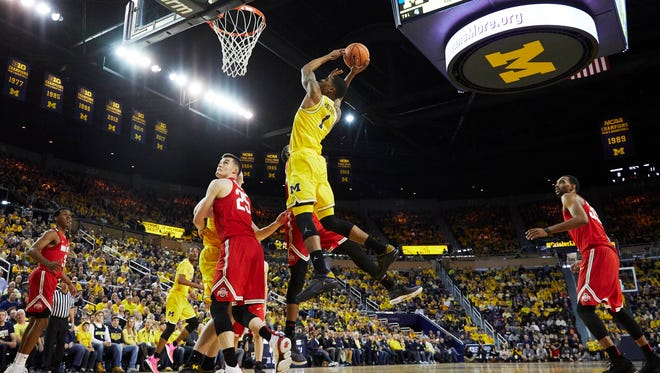 Michigan guard Charles Matthews (1) goes to the basket in the first half on Sunday, Feb. 18, 2018, at Crisler Center.