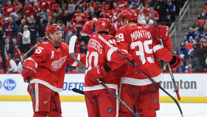 Red Wings right wing Anthony Mantha (39) celebrates his goal with teammates during the second period on Sunday, Feb. 18, 2018, at Little Caesars Arena.