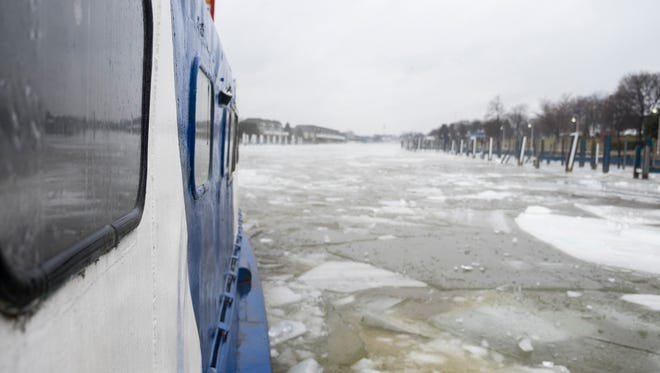 The L&R fishing tug from Sarnia breaks the ice on the Black River in Port Huron Feb. 20. The tug was brought in to break up the ice and help the river flow to help prevent flooding.