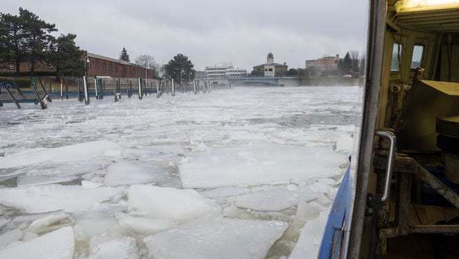 The L&R fishing tug from Sarnia breaks the ice on the Black River in Port Huron Feb. 20, 2018. The tug was brought in to break up the ice and help the river flow to help prevent flooding.