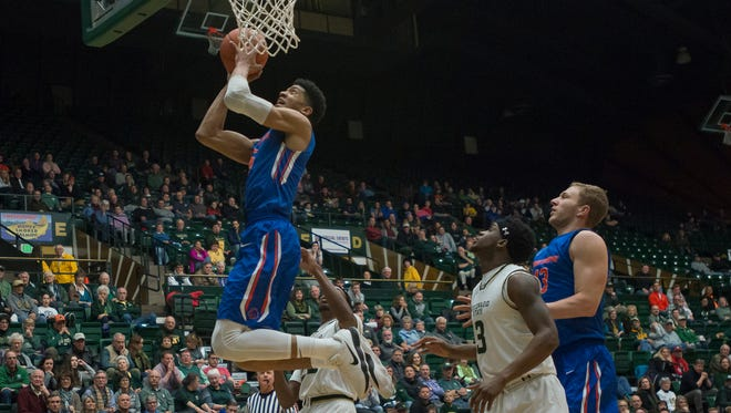Boise State senior guard Chandler Hutchison (15) goes up for a shot past CSU defenders on Wednesday, Feb. 21, 2018, at Moby Arena in Fort Collins, Colo.