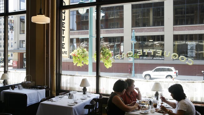 Large windows beside tables at Coquette Cafe in the Landmark Building, 316 N. Milwaukee St., provided a view of the Third Ward.
