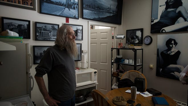Resident Dale Hartman gives a tour of his apartment where he has hung many of his paintings Thursday, Feb. 22, 2018, at The Northern Hotel in Fort Collins, Colo. Hartman will move from his apartment on the third floor to an apartment on the fourth floor when renovations are completed.