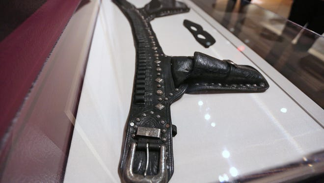 "This gun belt was worn by Clayton Moore in The Lone Ranger, c. 1945, seen in The Reel West exhibit at the Eiteljorg Museum, Thursday, March 1, 2018.  The exhibit, which runs Mar. 3, 2018 to Feb. 3, 2019, looks at ""morality, diversity, and American identity,"" seen through the Western film genre, Hollywood movies, and television shows.  This piece is on loan courtesy of the Autry Museum in Los Angeles."