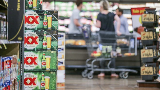 A customer strolls past the beer, wine and liquor section at Kroger, 1217 S. Rangeline Rd. in Carmel Ind. on Monday, Oct. 9, 2017.