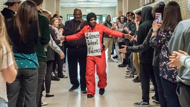 Bobby Holley gets a rousing send off from Pennfield High School students before his walk to Lansing to bring attention to school volience Monday Morning.