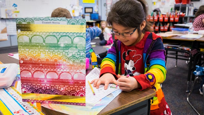 Avoca Elementary School student Elizabeth Monroy, 7, works on a writing excercise during class March 9.