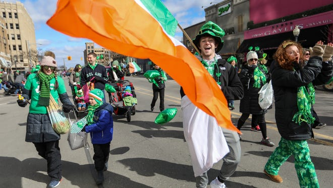 The O'Connell clan marches during the Oakland County St. Patrick's Day Parade 2018 in Royal Oak on Saturday, March 10, 2018.