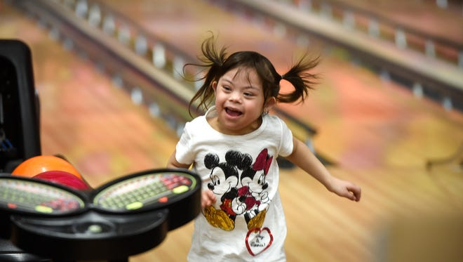 Jazlyn Navratil celebrates with glee while bowling during a Super Strikers bowling event Saturday, March 10, at Great River Bowl in Sartell.