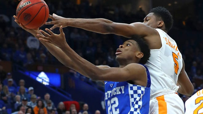 Mar 11, 2018; St. Louis, MO, USA; Kentucky Wildcats guard Shai Gilgeous-Alexander (22) is fouled as he puts up a shot against Tennessee Volunteers forward Admiral Schofield (5) during the second half of the SEC Conference Tournament Championship game at Scottrade Center. Kentucky won 77-72. Mandatory Credit: Billy Hurst-USA TODAY Sports