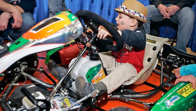 Jack Montes of Pewaukee tests a kid kart owned by the David Cass family at the Badger Kart Club booth during the 2014 Lake Country Community Fest at Kettle Moraine High School. This year's event runs from 10 a.m. to 3 p.m. Saturday, March 24.