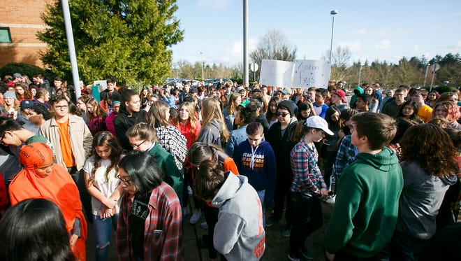 West Salem High School students observe several minutes of silence after walking out of class for a nationwide demonstration for gun safety in schools on Wednesday, March 14, 2018. The event lasted 17 minutes in honor of the 17 people killed in a school shooting in Parkland, Fla.