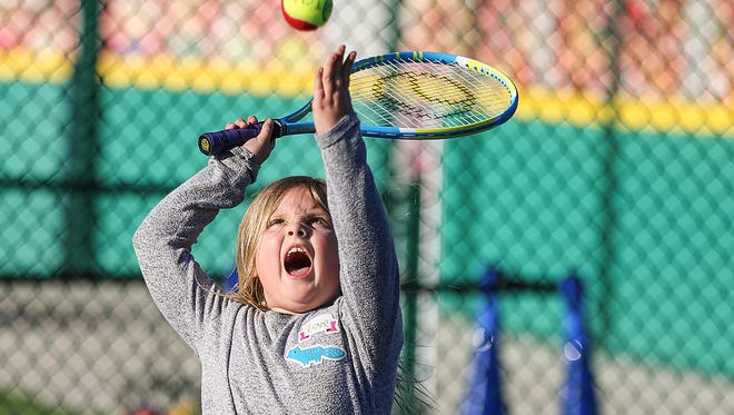 Emerson Bobenmoyer, 7, serves a tennis ball at the Seymour and Rheta Holt Tennis Center at the new Riley Children's Health Sports Legends Experience, during a preview event at the Children's Museum of Indianapolis, Thursday, March 15, 2018.