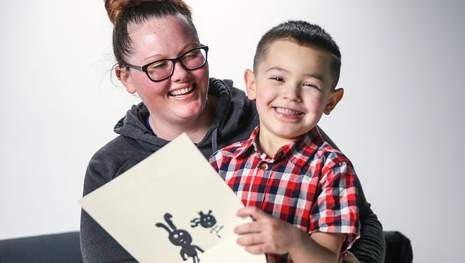 Giancarlo Gomez, 5, holds one of his drawings while sitting his mother Amie Welsh pose for a photo in the IndyStar studio in Indianapolis, Tuesday, March 6, 2018. In November of 2017, Giancarlo was diagnosed with restrictive cardiomyopathy, a rare form of heart muscle disease. Giancarlo is a level 2 patient on the list for a heart transplant and is well enough to live at home while on oral medications.