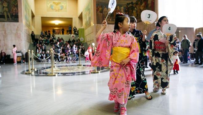 A kimono fashion show circles the rotunda at the annual Cherry Blossom Day on Saturday, March 17, 2018, at the Oregon State Capitol.