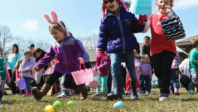 Aayla Johnson (left), Jolie Kowalkowski (center) race out to find eggs during the Dousman-Ottawa Lions' 2016 annual Easter egg hunt in Cory Park. This year's event is set for Saturday, March 31.