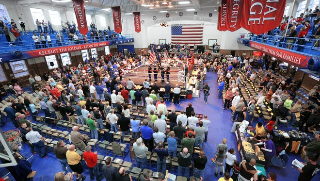 FILE-- American flag is presented during the national anthem at the start of the Indiana Golden Gloves  in 2015.