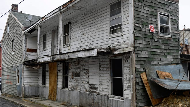 A condemned home at 218 E. Liberty Court in York City will be torn down on Thursday, March 29. Bernard Anthony from Bernard Anthony, Inc. was at the property on March 28 to prepare it for demolition.