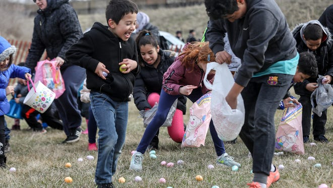 Kenny Gonzales, 7, and his cousin Richard Gonzalez-Elizondo, 12, both of Detroit, gather eggs during the egg hunt at the Detroit Parks and Recreation Annual Easter Fun Fest at Historic Ft. Wayne in Detroit on Saturday, March 31, 2018.