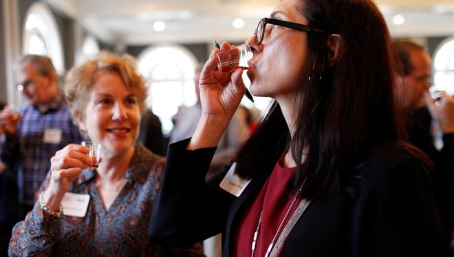 Lynne Fleming, right, and Margaret Horlander, left,  sample bourbon during a blind tasting. The event, held at The Olmsted, was hosted by the Bourbon Women Association and the Bourbon Brotherhood to see whether men or women have the better taste in bourbon. March 29, 2018