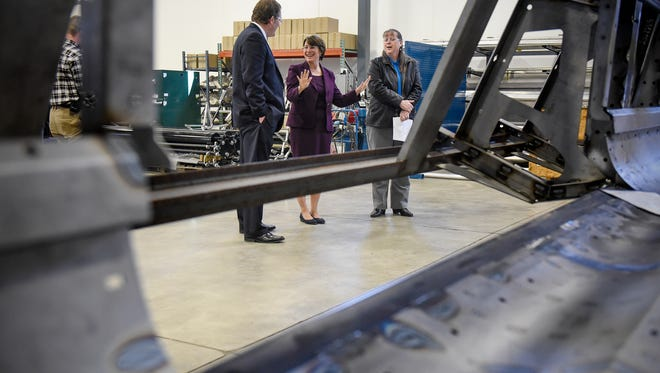 U.S. Sen. Amy Klobuchar talks with Geringhoff officials during a tour of the production facility Thursday, April 5, in St. Cloud.