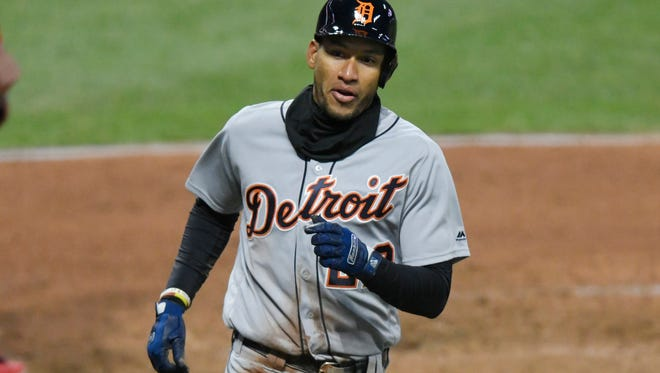 Detroit Tigers left fielder Victor Reyes (22) scores a run in the seventh inning against the Cleveland Indians at Progressive Field on April 10, 2018.