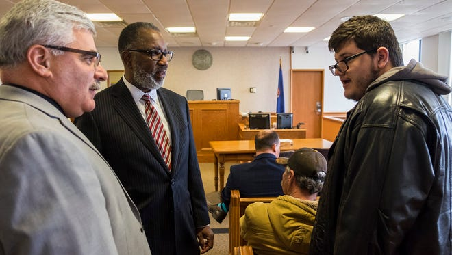 St. Clair County Probate Judge John Tomlinson, left, introduces Mental Health Court graduate Eric Szalas, right, to Supreme Court Justice Kurtis Wilder before the graduation ceremony in the St. Clair County Circuit Courthouse Tuesday, April 17. Szalas is one of six people graduating from the program this year.