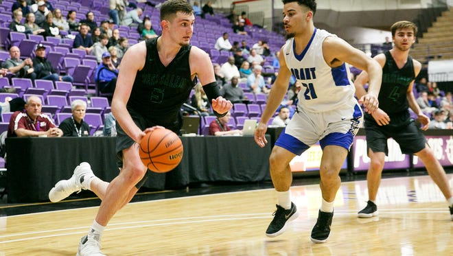 West Salem's Kyle Greeley (5) dribbles around Grant defense in a Class 6A state quarterfinal game on Thursday, March 8, 2018, at University of Portland. West Salem lost to Grant 72-57.