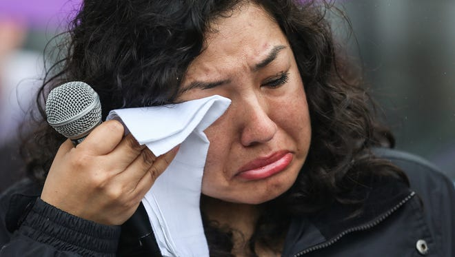 Erika Fierro becomes emotional during a prayer vigil held before her supervision check-in at the Intensive Supervision Appearance Program office in Indianapolis, Tuesday, April 24, 2018. Faith in Indiana planned the gathering to show solidarity with Fierro, an undocumented mother of two who was arrested by Immigration and Customs Enforcement recently. Her husband is already in custody for deportation.