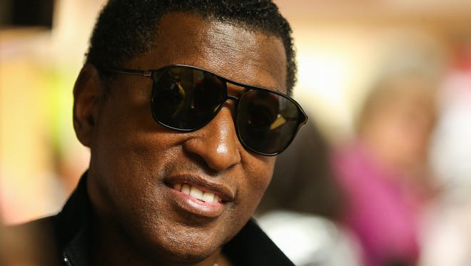 """Kenny """"Babyface"""" Edmonds visits his alma mater, North Central High School in Indianapolis, Tuesday, April 24, 2018."""